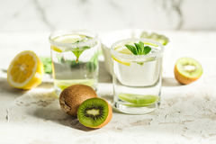 Fruit drink with kiwi and mint Stock Photos