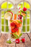 Fruit drink on rustic wooden table Royalty Free Stock Image
