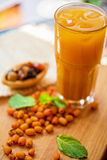 Fruit drink with sea buckthorn Stock Images