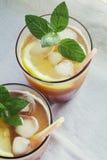 Fruit drinks. Fresh apricot juice with lemon royalty free stock image