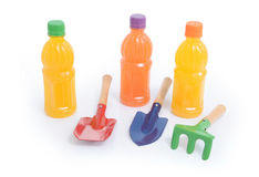 Fruit drinks and gardening tools Stock Images