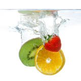 Fruit dropped in the water Royalty Free Stock Photography