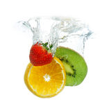 Fruit dropped in the water Royalty Free Stock Images