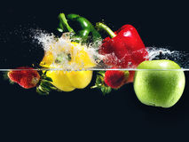 Fruit dropping Stock Images