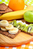 Fruit and dry loaves with curd. Royalty Free Stock Photo