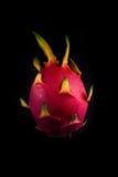 Fruit du dragon sur un fond noir Photographie stock