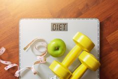 Fruit, dumbbell and scale, fat burn and weight loss stock photography