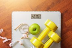 Fruit, dumbbell and scale, fat burn and weight loss royalty free stock photography
