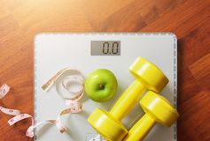 Fruit, dumbbell and scale, fat burn and weight loss concept Stock Photography