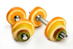 Fruit dumbbells - healthy lifestyle and eating concept Royalty Free Stock Photo