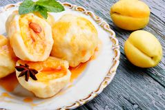 Fruit dumplings with apricot. And spicy syrup stock image