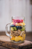 Fruit end granola salad brunch in mason jar Royalty Free Stock Photo