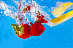 Fruit entering the water Royalty Free Stock Images