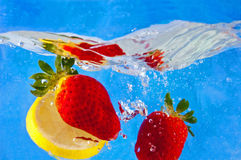 Fruit entering the water Royalty Free Stock Photo