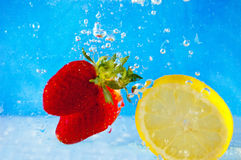 Fruit entering the water Royalty Free Stock Photos