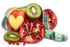 Fruit et mètre Photographie stock