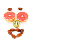 Fruit Expressions--Happy. Grapefruit, kiwi and whole dates form fruit expressions Stock Images