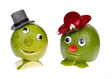 Fruit faces. Funny fruit with face, googly eyes and hat stock photography