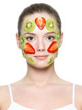 Fruit facial mask of strawberry and kiwi Stock Photography