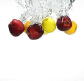 Fruit falling in water Stock Image