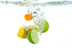 Fruit falling in water. Fruit falling into clear water stock images