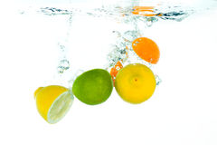 Fruit falling in water Stock Images