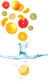 Fruit falling in water. Citrus fruit falling in water with splash and bubbles Royalty Free Stock Image