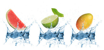 Fruit falling into water Royalty Free Stock Image