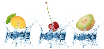 Fruit falling into water Stock Photo