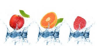 Fruit falling into water Royalty Free Stock Photo