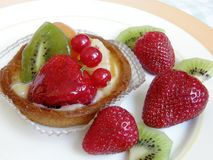 Fruit fancy tart. A fruit fancy tart and fresh strawberry and kiwi on a plate Royalty Free Stock Photography