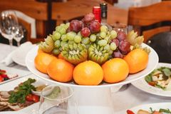 Fruit on a festive table royalty free stock image
