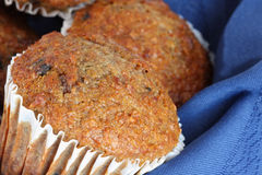 Fruit and fibre muffins. Close-up of delicious fruit and fibre muffins on blue napkin Stock Photos