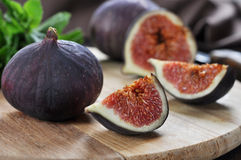 Fruit figs. Fresh sweet fruit figs on a wooden board Royalty Free Stock Photography