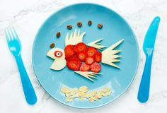Fruit fish - fun with food, creative summer snack. For children royalty free stock photography