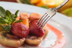 Fruit flambe on white plate. Stock Photography