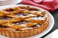 Fruit Flan. Glazed fruit flan with lattice top, ready for cutting.  Could be cherry pie, or strawberry.  Delicious Stock Image