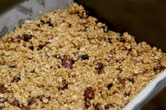 Fruit flapjack mix ready to bake in the oven.  Stock Photography