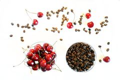 Fruit flavor favorite drink. Roasted Arabica coffee grains next to the cherry. View from above royalty free stock photography