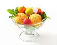 Fruit-flavored ice cream and pralines Stock Photography