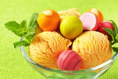 Fruit-flavored ice cream and pralines Royalty Free Stock Photography