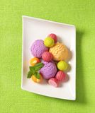 Fruit-flavored ice cream and pralines Royalty Free Stock Images