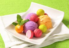 Fruit-flavored ice cream and pralines Stock Photo