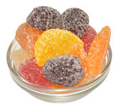Fruit Flavoured Jellies. An assortment of fruit flavoured jelly sweets in a glass bowl, isolated on a white background Royalty Free Stock Image
