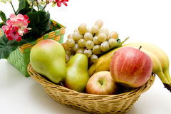 Fruit and flowers. Fresh fruit in the basket with flowers Royalty Free Stock Photos