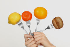 Fruit on a fork Stock Image
