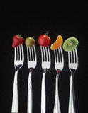 Fruit and forks Royalty Free Stock Photos