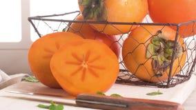 Fruit frais délicieux de kaki clips vidéos