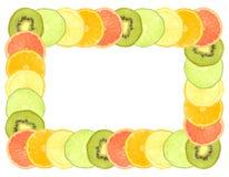 Fruit frame. Sliced citrus fruit frame isolated on white Royalty Free Stock Photo