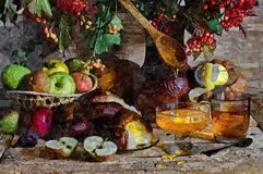 Fruit, fresh bread and honey. Autumn harvest. Rustic still-life. Painting wet watercolor on paper. Naive art. Abstract art. Drawing watercolor on paper stock illustration